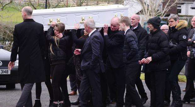 Close family and friends carry Shannon's coffin into St Joseph's Church in Dunloy