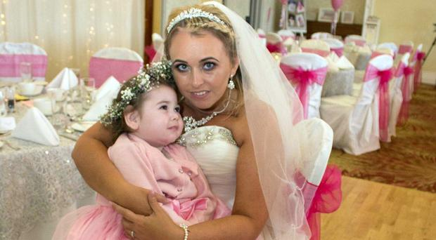 Lacey Pollock with mum Jamie on her wedding day