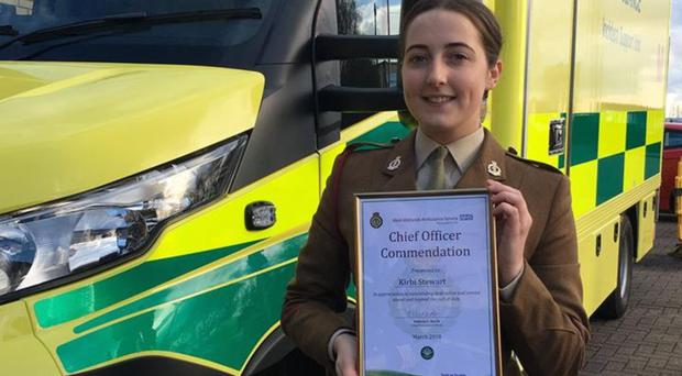 Private Kirbi Stewart with the award she was given yesterday for trying to help a family who had been attacked