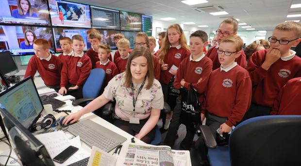 Deputy news editor Claire Williamson shows the young reporters the ropes