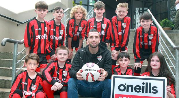 Young footballers from Derry Colts with Brighton and Republic of Ireland footballer Shane Duffy at the launch of the Foyle Cup earlier this month
