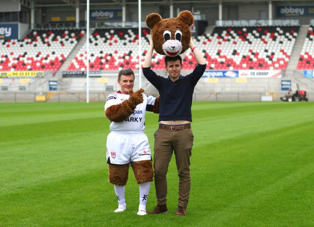 Norman Pollock (left), who was Ulster Rugby mascot Sparky for 18 years, hands over the costume for a day to Belfast Telegraph reporter Gerald Lennon
