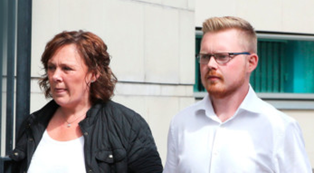 Yvonne and Kyle Black, widow and son of David Black, outside court