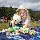 Lucy Woods from Annalong enjoys the annual Music in the Park at Silent Valley in Co Down yesterday