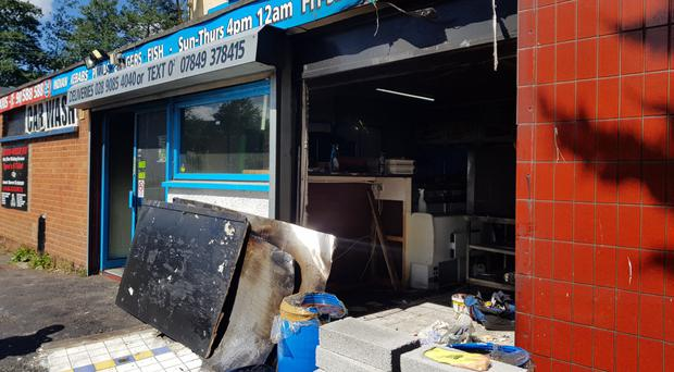 The damage to the Bombay Dreams takeaway on the Rushpark estate, Newtownabbey