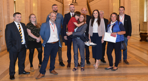 Billy Caldwell and his mother Charlotte with a cross-party group of politicians at Stormont yesterday