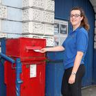 Aine Rice from Newry posts a letter at Market Street in Lurgan