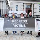 Campaigners for historical institutional abuse outside the High Court in Belfast yesterday where they were challenging the Secretary of State for Northern Ireland