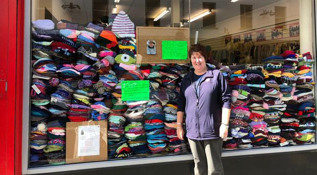 Doreen Armstrong outside The Salvation Army shop with some of the hats