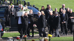 Family and friends carry the coffin of Mark Lynn for burial in Ballymena