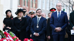Secretary of State Karen Bradley, Deputy Lord Mayor of Belfast Emmet McDonough-Brown and Tanaiste Simon Coveney TD at the Remembrance Service at Belfast City Hall yesterday