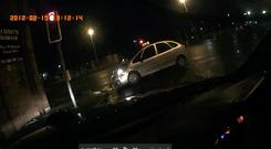 The footage from his dash cam showing the moment of impact after a driver ran a red light and crashed into his car