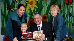 Eryn Kirkpatrick with mum Evanna (left), Fivemiletown Primary School Principal Melanie Houston (right) and Maghaberry governor David Kennedy