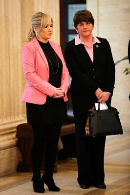 Michelle O'Neill and Arlene Foster wait to sign the book of condolence after the death of Martin McGuinness