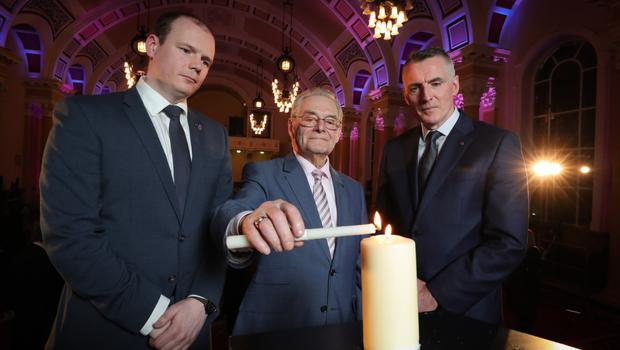 Junior Ministers Gordon Lyons (left) and Declan Kearney (right) with Holocaust survivor Tomi Reichental at Belfast City Hall