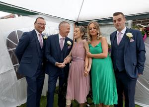 Samantha Gamble and Frankie Byrne (centre) after their wedding yesterday, with Kevin McGuinness and Samantha's children, Jessica and Stephen