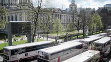 Translink Metro buses outside Belfast City Hall (David Young/PA)