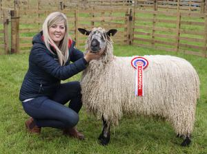 Laura Kerr with her champion rare breed Teeswater
