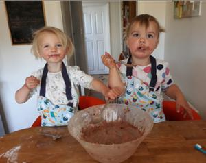 Twins Khloe and Keira baking a cake for a NHS competition