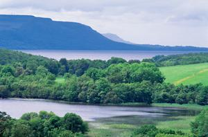 Nature under attack: Lower Lough Erne and the view over Cleenishgarve Island, towards Lough Navar Forest