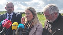 PSNI Detective Superintendent Jason Murphy, left, with Joanne Dorrian, sister of Lisa and her father John Dorrian, at a disused airfield in Ballyhalbert, Co Down, where fresh searches for Lisa are taking place (Rebecca Black/PA)