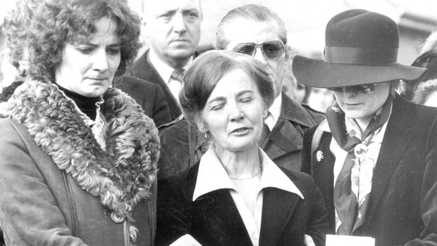 Ingeborg Niedermayer is comforted by daughters Gabrielle (left) and Renate at the funeral of her husband Thomas in 1980