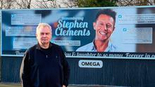 The picture Eamonn Holmes posted on his Twitter account standing in front of the Stephen Clements poster in Carrickfergus