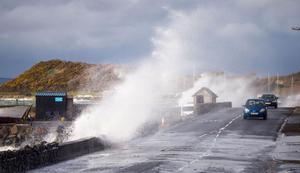 Drivers battling with the strong winds and high tides on the Portaferry Road near Kircubbin, Co Down, yesterday