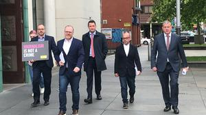 Patrick Corrigan of Amnesty International (left), journalist Trevor Birnie, solicitor John Finucane, journalist Barry McCaffrey and solicitor Niall Murphy at outside the Royal Courts of Justice in Belfast. (Rebecca Black/PA)