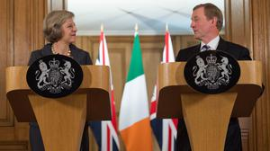 Theresa May and Enda Kenny have called for the snap election in Northern Ireland to be conducted in a 'respectful' manner