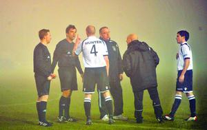 PACEMAKER PRESS  19/2/2013 Lisburn Distillery v Dundela Irish Cup 6th Round replay Lisburn's Andy Hunter show's his frustration to Referee Andy Davey as he stop's the match when Distillery are 3-0 up on Dundela. The match was stopped due to heavy fog during this evenings game in the Irish cup 6th round.Photo Mark Marlow/Pacemaker Press