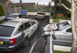 The four family cars after arson attack in Derry's Barr's Lane