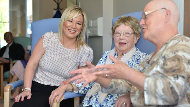 Michelle O'Neill talking to patients in her role as Health Minister
