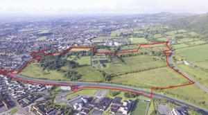 The site of the proposed Glenmona development in west Belfast. It will include 550 social housing properties and 106 affordable housing properties