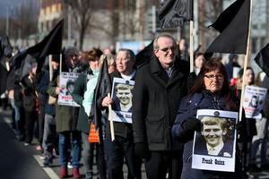 Relatives of people killed in Northern Ireland's Troubles marched with pictures of their loved ones (Brian Lawless/PA)