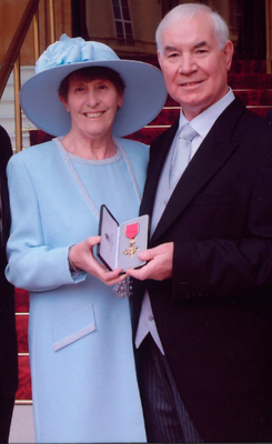 Former Mayor of Lisburn Ivan Davis with his wife Betty after he received his OBE from the Queen at Buckingham Palace