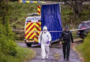 Police and forensic officers at the scene of a man's death on the Dromore Road in Hillsborough yesterday