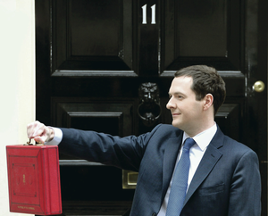 Chancellor George Osborne leaves 11 Downing Street for Parliament yesterday with the details of the Budget