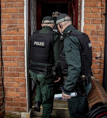 Officers on a raid in north Belfast