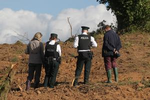 PSNI officers at the sett in Hillsborough where 50 badgers were buried alive following work by a developer