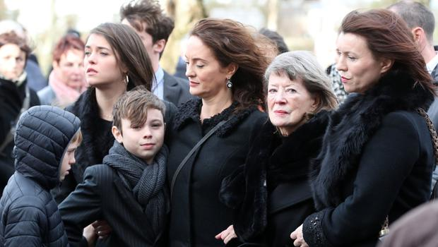 Francie Brolly's wife Anne and family at the former politician's funeral at St Patrick's Church in Dungiven