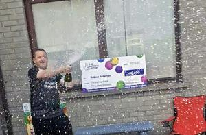 Robert sprays the bubbly rather than the paint after scooping his big win