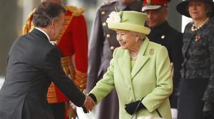 The Queen greets Colombia's president Juan Manuel Santos during a ceremonial welcome on Horse Guards Parade in central London