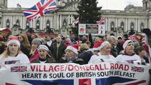 Loyalist protesters prepare to set off during the march from Belfast City Hall