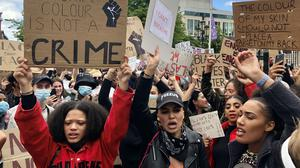People participate in a Black Lives Matter protest rally march through Donegall Square in Belfast, in memory of George Floyd who was killed on May 25 while in police custody in the US city of Minneapolis.
