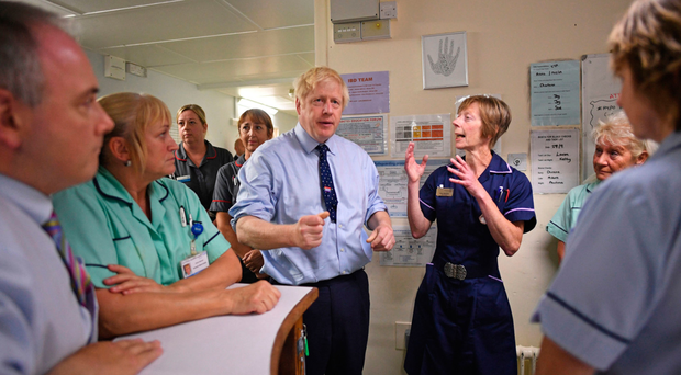 Prime Minister Boris Johnson visits The Princess Alexandra hospital in Harlow, Essex, yesterday for an announcement on new patient scanning equipment