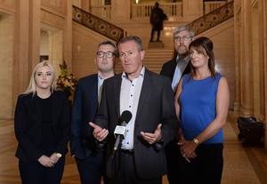 Sinn Fein's Conor Murphy with party colleagues at Stormont yesterday