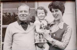 Naomi Long as a one-year-old with parents Emily and James