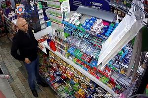CCTV of Gheorghe Nica purchasing a mobile phone top-up on October 13 last year (Essex Police/PA)