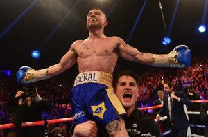 Just champion: Carl Frampton celebrates after his powerful win over American Chris Avalos at the Odyssey